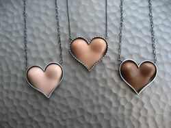 Margaux Lange Barbie boobs heart necklaces
