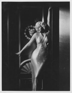 Jean Harlow Dinner at Eight satin dress at door © Pancho Barnes Trust Estate Archive