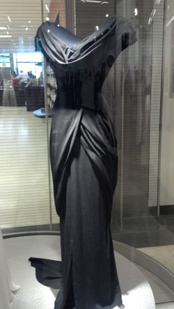 "Black silk evening gown by Walter Plunkett, worn by Hepburn as Amanda Bonner in Adam's Rib [MGM, 1949]; Kent State University Museum, KSUM 2010.12.4, Gift of the Estate of Katharine Hepburn. Designed to accent her 20"" waist, this gown was colored red by the MGM publicity department for the lobby card, right."