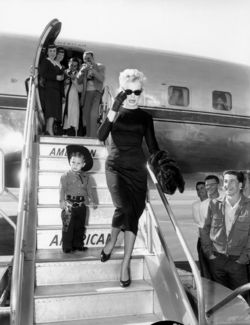 Marilyn Monroe disembarking with little cowboy